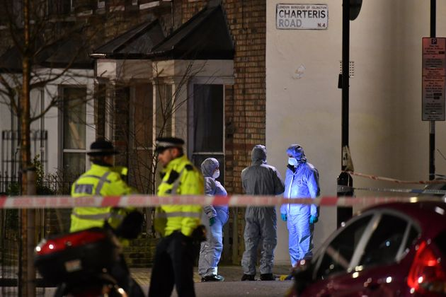 Forensic officers at the crime scene after Metropolitan police cordon off Charteris Road close to the...