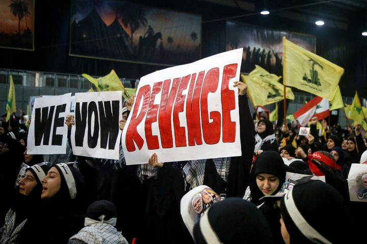 Supporters of Lebanon's Iran-allied Hezbollah movement on Sunday hold banners vowing for revenge for the death of Iranian Gen