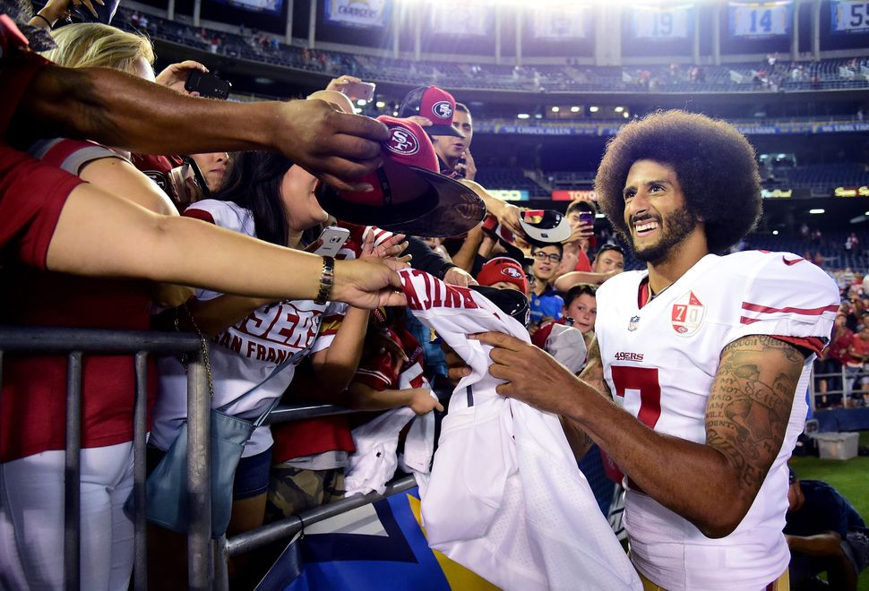 San Francisco 49ers quarterback Colin Kaepernick signs autographs for fans after a 31-21 win over the San Diego Chargers on S