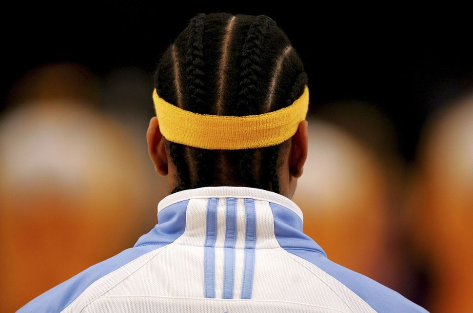 Iverson of the Denver Nuggets stands for the national anthem before a game with the Los Angeles Lakers on Jan. 5, 2007.