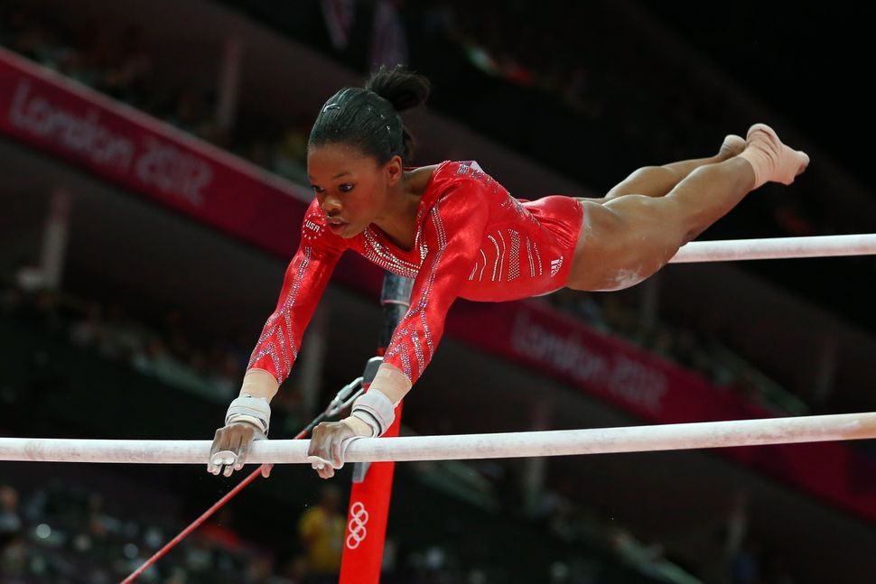 Gabby Douglas competes on the uneven bars in the artistic gymnastics women's team final at the London Olympics on July 31, 20