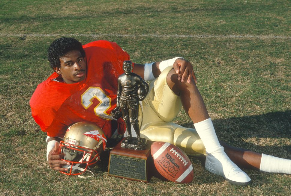 Defensive back Deion Sanders of the Florida State Seminoles poses with his 1988 Jim Thorpe Award trophy in Tallahassee.