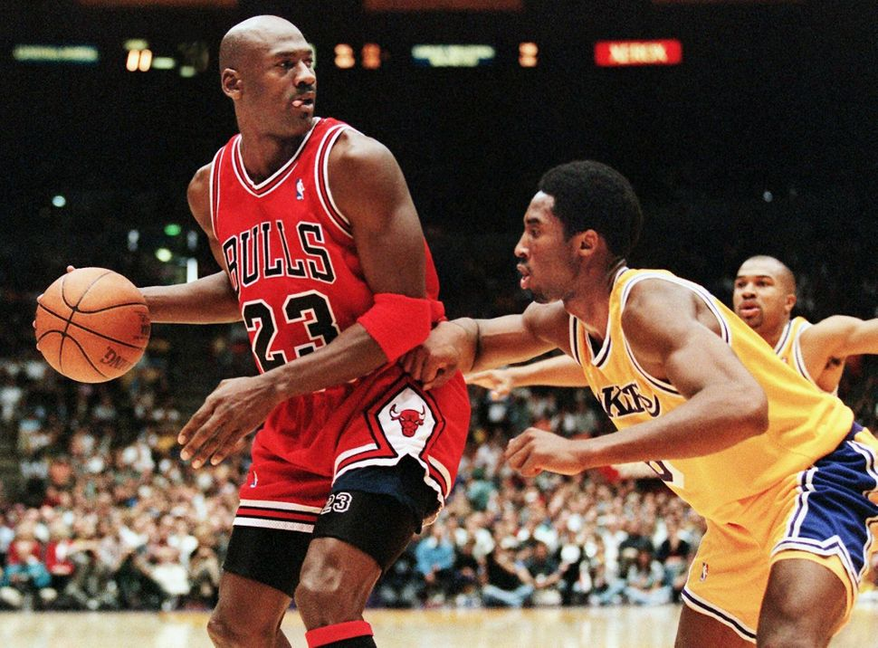 Jordan eyes the basket as he is guarded by Kobe Bryant of the Los Angeles Lakers in a Feb. 1, 1998, game.