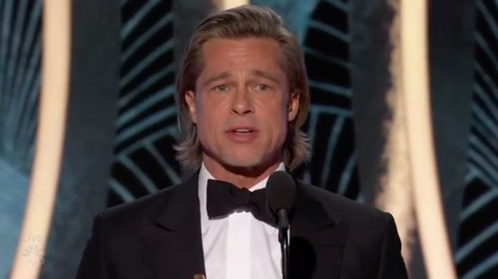 Brad Pitt accepts the Best Supporting Actor award