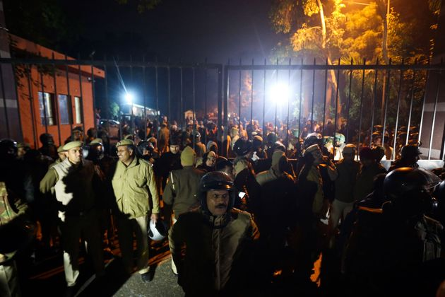 Police gather outside a gate of the Jawaharlal Nehru University (JNU) following violence on January 5,