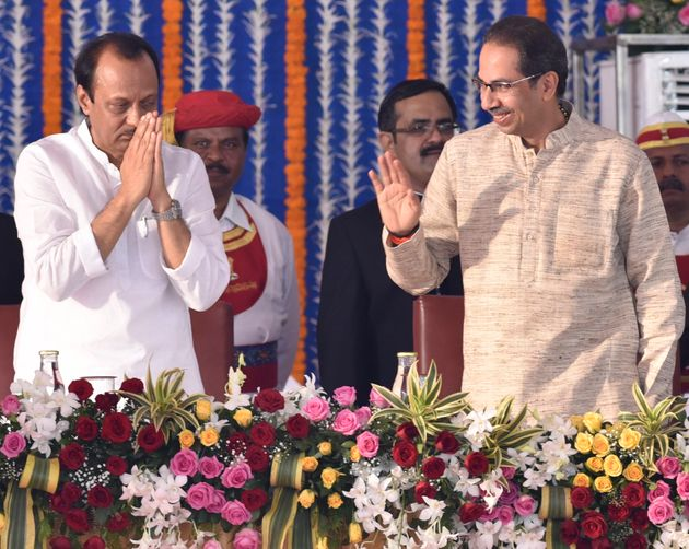 Ajit Pawar and Uddav Thackeray during the swearing-in ceremony of Maharashtra cabinet at Vidhan Bhavan,...