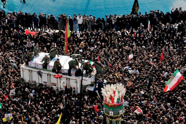 Coffins of Gen. Qassem Soleimani and others who were killed in Iraq by a U.S. drone strike, are carried...