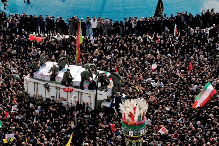 Coffins of Gen. Qassem Soleimani and others who were killed in Iraq by a U.S. drone strike, are carried on a truck surrounded