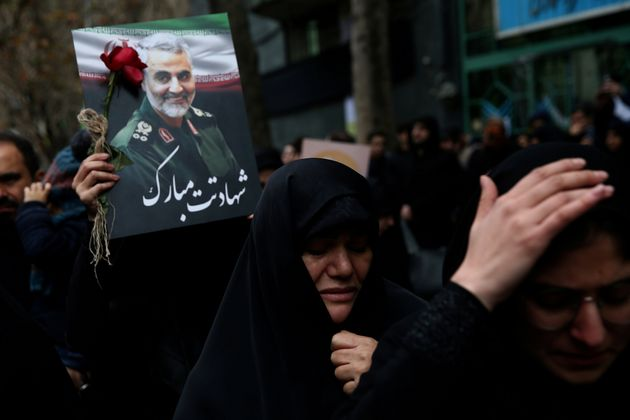 Iranian women react as they gather to mourn Gen. Qassem Soleimani who was killed in an air strike at...