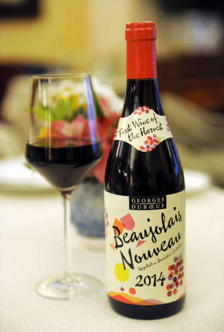 IMAGE DISTRIBUTED FOR LES VINS GEORGES DUBOEUF - The 2014 Georges Duboeuf Beaujolais Nouveau arrives in the U.S., Wednesday, Nov. 19, 2014, in New York.   According to French law, the wine is released on the third Thursday of each November.  (Photo by Diane Bondareff/Invision for Les Vins Georges Duboeuf/AP Images)