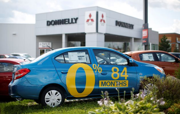 A car advertises an 84-month loan term at a Mitsubishi dealership in