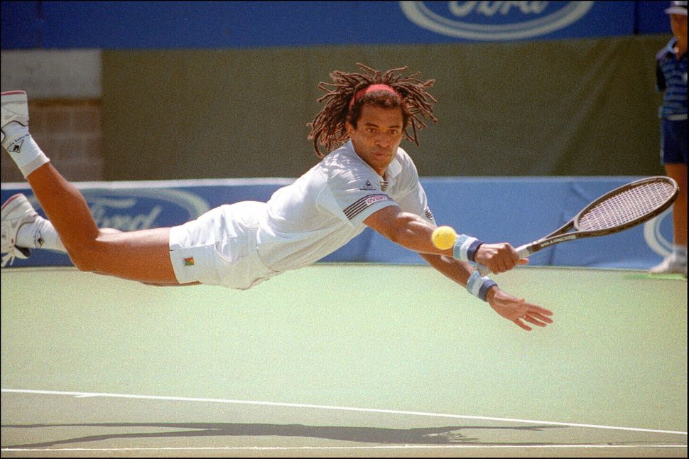 Yannick Noah dives for a return during his Australian Open match against Gilad Bloom of Israel on Jan. 19, 1990.