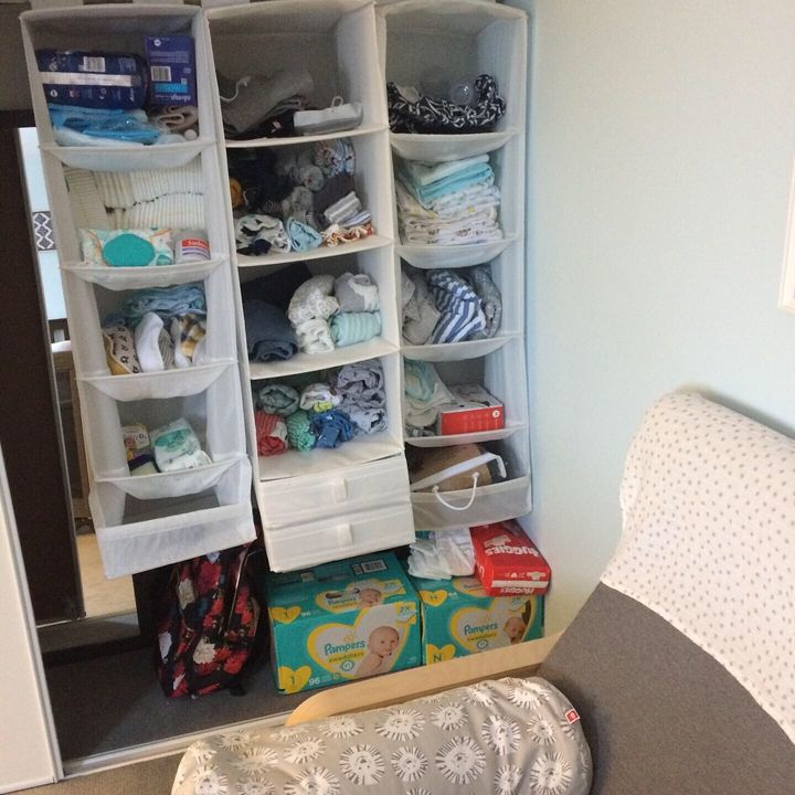 Some hanging shelves transformed my side of the closet into storage for all the crap a baby needs.