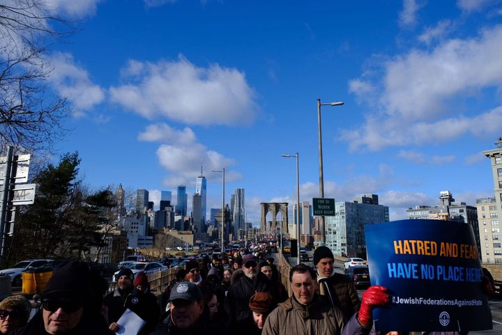Demonstrators crossed the Brooklyn Bridge as they made their way to Cadman Plaza, where community leaders spoke against anti-