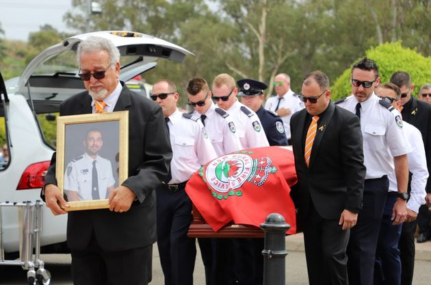 With hand on heart, Australian firefighters mourn