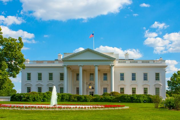 White House on a bright summer day with fluttering US