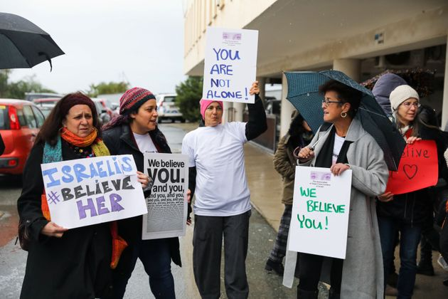 Activists take part in a demonstration outside the Famagusta courthouse in Paralimni, Cyprus on