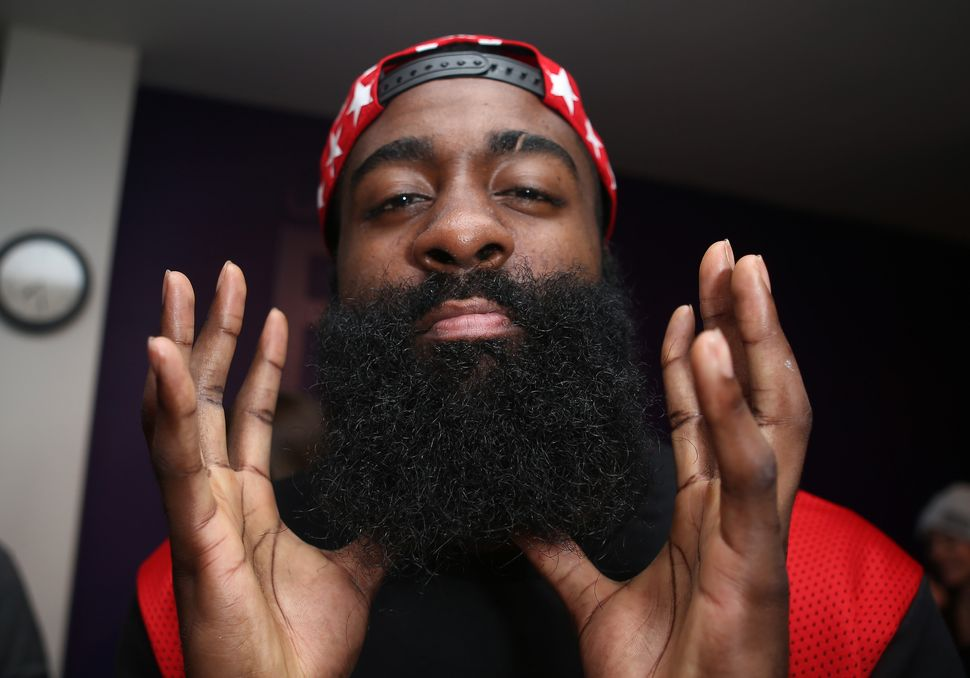 James Harden shows off his beard during a presentation by New Era Cap, which makes the caps for MLB, on Feb. 11, 2016, in Tor