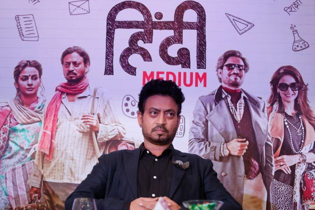 Irrfan Khan sits during a press conference to promote
