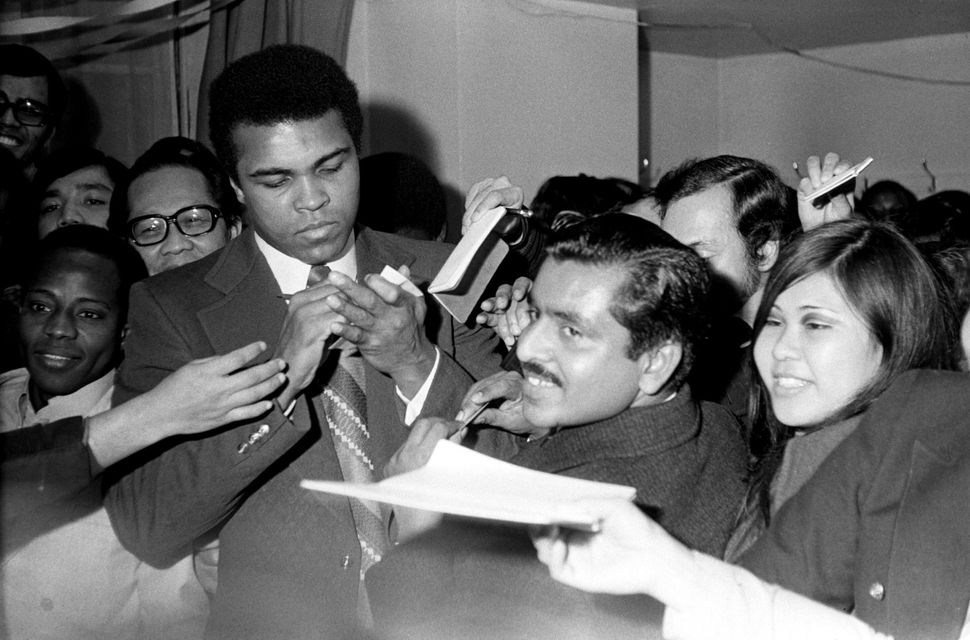 The future Muhammad Ali signs autographs for adoring fans two days before his Feb. 10, 1962, bout with Sonny Banks in New Yor