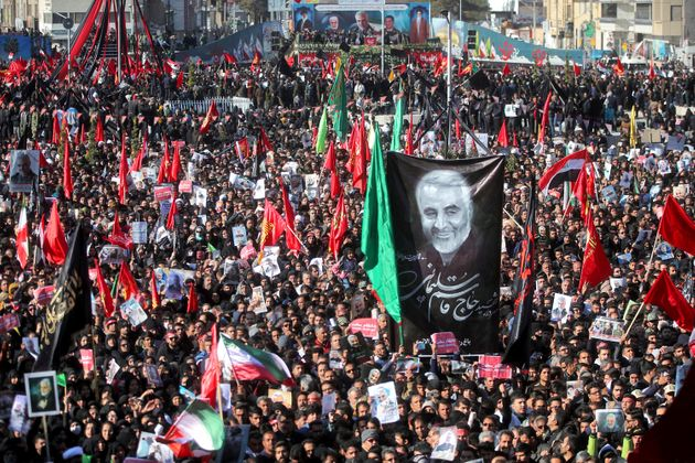 Mourners attend a funeral ceremony for Iranian general Qassem Soleimani and his comrades, who were killed...