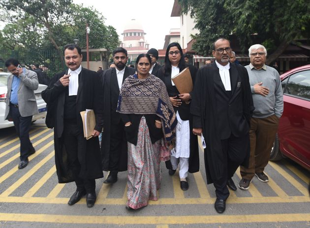 Asha Devi, mother of the December 16 gang rape case victim, leaves Supreme Court ahead of the hearing...