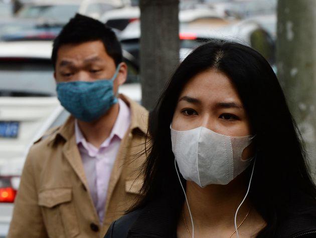 À l'approche du Nouvel An chinois, les autorités s'inquiètent d'une étrange forme de pneumonie - Le HuffPost