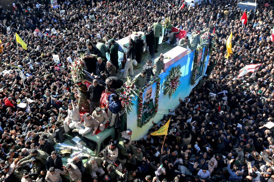 Coffins of Gen. Qassem Soleimani and others who were killed in Iraq by a US drone strike, are carried...