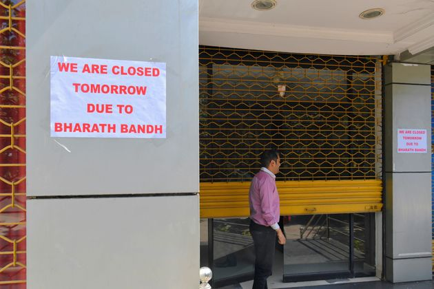A sign announcing closure due to strike at the entrance of an office building during a nationwide strike,...