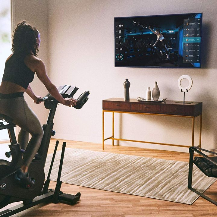The Flywheel Home Bike in action: The deal includes a free two-month subscription to cycling and strength workouts.