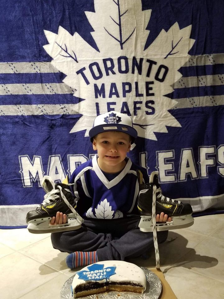 Jacob at a previous birthday party, with the right kind of 'Maple Leafs' cake.