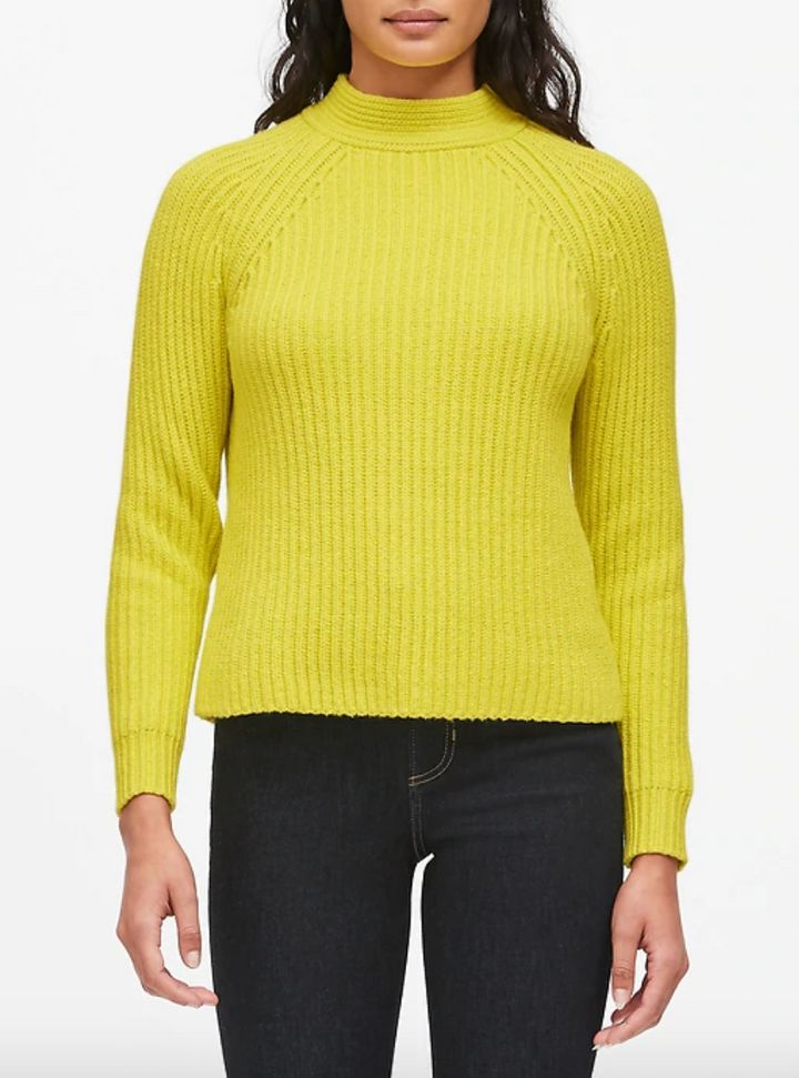 "You'll feel like the sun, even when it's cold outside, with such a can't-miss color. <strong><a href=""https://fave.co/2FseTGH"" target=""_blank"" rel=""noopener noreferrer"">Find this sweater at Banana Republic</a></strong>."
