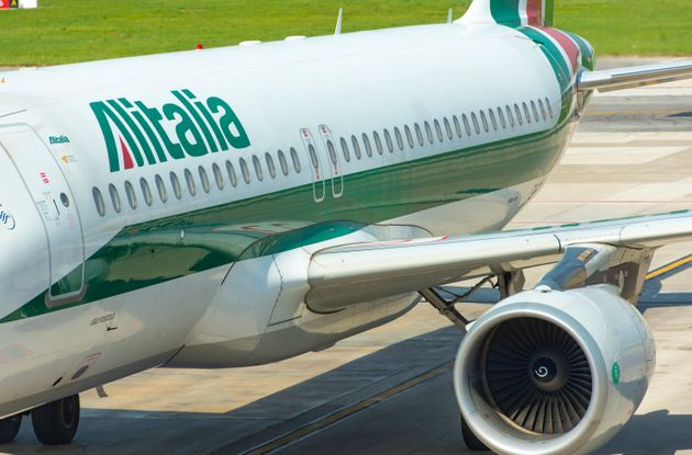 Plane of Alitalia, taxiing before take off in Naples airport in