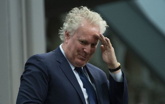 Former Quebec premier Jean Charest stands as he is recognized by the Speaker of the House of Commons...