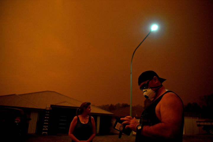 Locals use phone apps to get updates on the fire and to anticipate its movements as high winds push smoke and ash from the Currowan Fire towards Nowra, New South Wales, Australia January 4, 2020. REUTERS/Tracey Nearmy