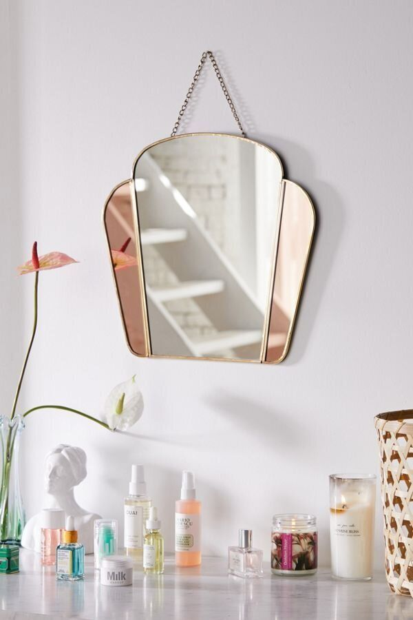 "You can look back to the past with this Art Deco-inspired mirror. <a href=""https://fave.co/35sUMT3"" target=""_blank"" rel=""noopener noreferrer""><strong>Find this mirror at Urban Outfitters</strong></a>."