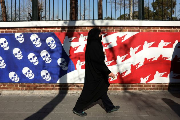 A mourner walk back from a funeral ceremony for Iranian Gen. Qassem Soleimani and his comrades, who were...