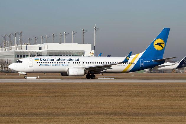 AIRPORT MUNICH, MUNICH, GERMANY - 2019/02/16: Ukraine International Airlines (UIA) Boeing 737-800 seen...