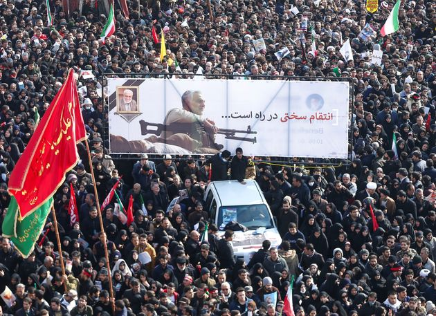 Iranian people attend a funeral procession for Iranian Major-General Qassem Soleimani, head of the elite...