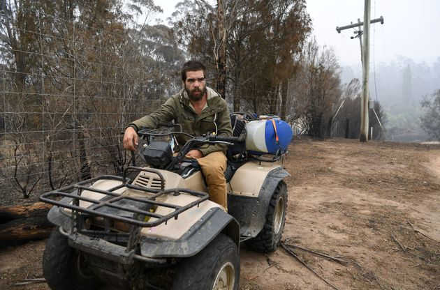 Local Aboriginal man Anthony Thomas is seen at his uncle's property destroyed by bushfires in Kiah, Australia...