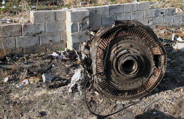 An engine lies on the ground after a Ukrainian plane carrying 176 passengers crashed near Imam Khomeini...