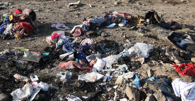 Personal belongings and debris are pictured scattered on the ground after a Ukrainian plane carrying...