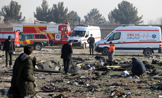 Rescue teams work amidst debris after a Ukrainian plane carrying 176 passengers crashed near Imam Khomeini...