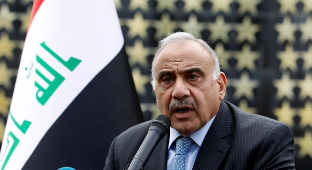 Iraqi Prime Minister Adel Abdul Mahdi speaks during a symbolic funeral ceremony of Major General Ali...