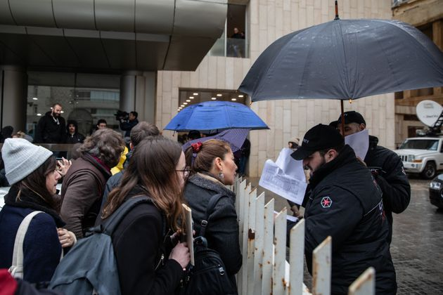 BEIRUT, LEBANON - JANUARY 08: Security guards check a list of press members allowed access to the former chairman of Nissan and Mitsubishi Motors Carlos Ghosn's press conference on January 08, 2020 in Beirut, Lebanon. The former chairman of Nissan was awaiting trial in Japan on charges of financial crimes when he fled house arrest in Tokyo, arriving in Beirut on December 30. (Photo by Chris McGrath/Getty Images)
