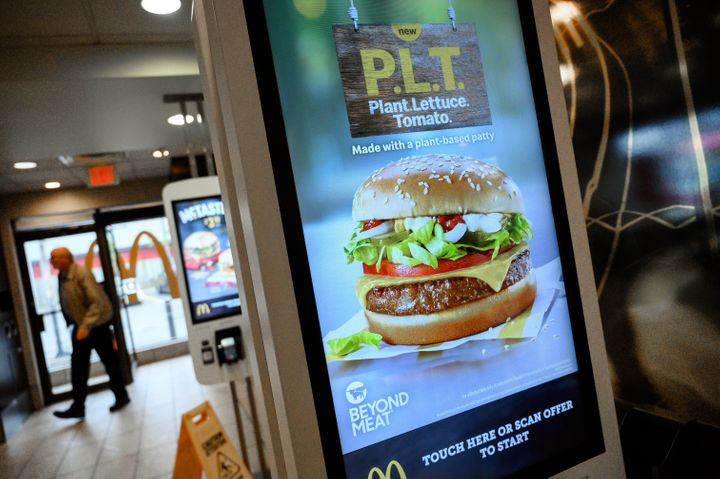 """A sign promoting McDonald's """"PLT"""" burger with a Beyond Meat plant-based patty at one of the test restaurant locations in London, Ont., Oct. 2, 2019."""
