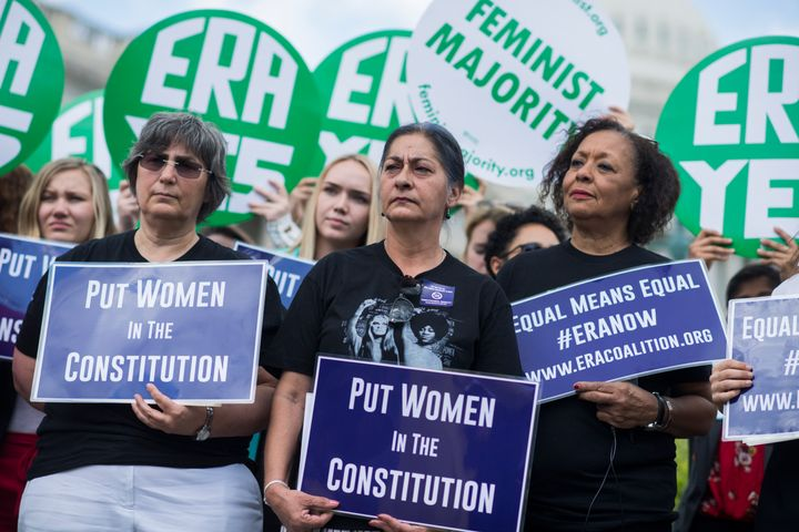 Jessica Lenahan, center, a domestic violence survivor, and Carol Jenkins, right, of the Equal Rights Amendment Task Force, at