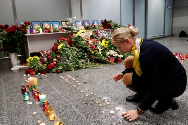 A collegue of the flight crew members of the Ukraine International Airlines Boeing 737-800 at a memorial...