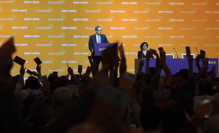 NDP delegates show hands as they vote on resolutions in Ottawa on Feb. 16, 2018.