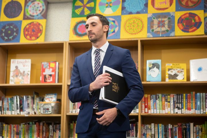 Ontario Education Minister Stephen Lecce stands in the library at Ogden Junior Public School after making an announcement in Toronto on Nov. 27, 2019.